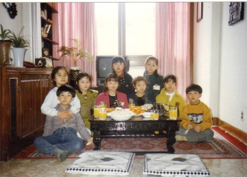 at Jiwon's birthday party many years ago.  Jiwon is on the far left with her arms around Daesung and I'm on the far right