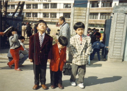 left to right: 7-year old me, my younger brother and my formerly lost BFF Daesung on our first day of elementary school.  (already starting with that suit jacket...)